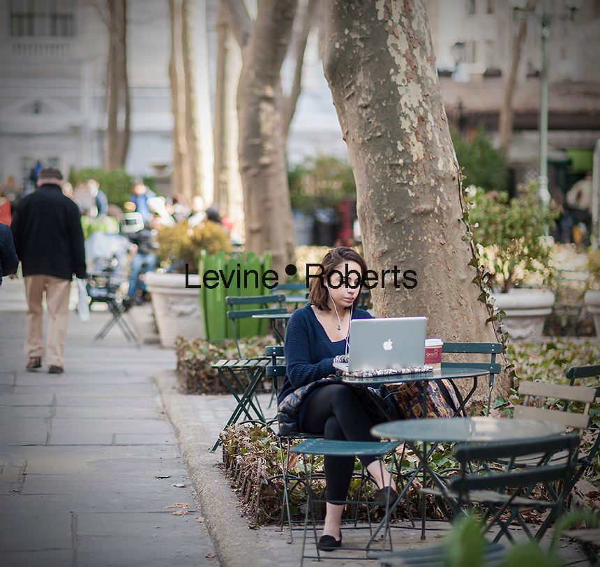 Visitors to Bryant Park uses take advantage of the free wi-fi with their laptop computers in New York on Friday, March 21, 2014. Friday was the first full day of Spring heralding in balmy weather for the first half of the weekend. Sunday, the temperature will drop back into the 40's. (© Richard B. Levine)