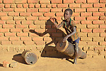 Edson Nirenda, age 6, plays a drum in Chibamu Jere, Malawi.