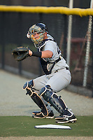 Pulaski Yankees catcher Jesus Aparicio (45) warms up his starting pitcher in the bullpen prior to the game against the Burlington Royals at Burlington Athletic Park on August 6, 2015 in Burlington, North Carolina.  The Royals defeated the Yankees 1-0. (Brian Westerholt/Four Seam Images)