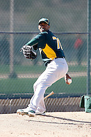 Yadel Marti #70 of the Oakland Athletics participates in spring training workouts at the Athletics complex on February 23, 2011  in Phoenix, Arizona. .Photo by:  Bill Mitchell/Four Seam Images.