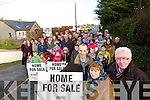 Aidan Linnane, Peggy O'Connell and Gerard Doyle with locals in the Finuge area protesting at the proposed windfarm in the area.