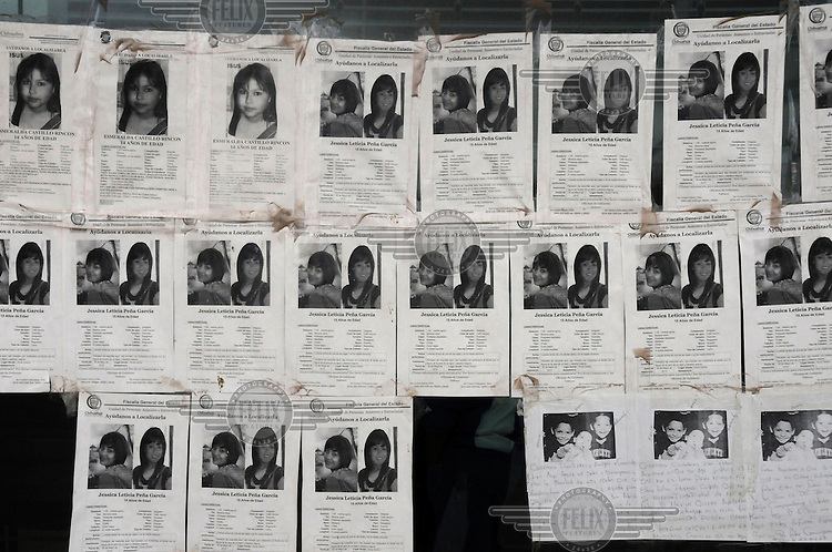 Posters of missing girls are posted on the walls of the Fiscalia, the Public Prosecutor's office on the Avenida Ejercito Nacional. Hundreds of girls and young women have gone missing in Juarez over the last ten years.