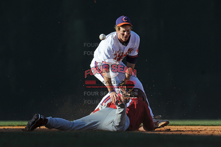 Mike Freeman (Second Baseman) Clemson Tigers attempts to put a tag on the sliding Scott Wingo of the South Carolina Gamecocks as the ball comes loose (Photo by Tony Farlow/Four Seam Images)