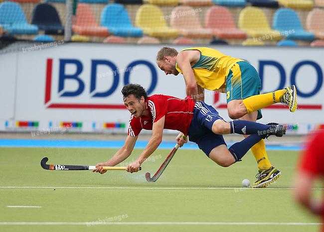Mens Champions Trophy, Monchengladbach 2010.Day 3, Australia V England 3/8/10.Rob Moore dives under pressure from Australias Luke Doerner.Credit: Grant Treeby.Editorial use only(No Archiving)
