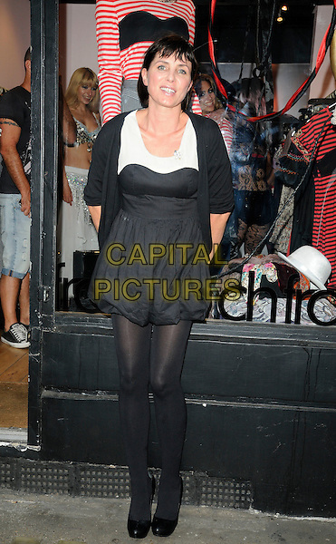 SADIE FROST .At the Cirque Du FrostFrench event, FrostFrench boutique Soho, London, England, UK,  14th July 2010..full length black dress bubble hem puffball cardigan white tights mini shoes .CAP/CAN.©Can Nguyen/Capital Pictures.