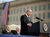 Arlington, VA - September 11, 2008 -- United States President George W. Bush speaks at the dedication of the September 11th Memorial at the Pentagon on the 7th anniversary of the September 11, 2001 attacks on New York and Washington in Washington, DC, Thursday, September 11, 2008. Watching him are former Secretary of Defense Donald Rumsfeld (left) and current Secretary of Defense Robert Gates.  .Credit: Joshua Roberts - Pool via CNP