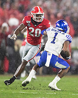 ATHENS, GA - OCTOBER 19: Lynn Bowden Jr. #1 of the Kentucky Wildcats evades a tackle by J.R. Reed #20 of the Georgia Bulldogs during a game between University of Kentucky Wildcats and University of Georgia Bulldogs at Sanford Stadium on October 19, 2019 in Athens, Georgia.