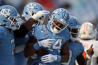 CHAPEL HILL, NC - NOVEMBER 23: Emery Simmons #14 of the University of North Carolina celebrates a touchdown with teammates during a game between Mercer University and University of North Carolina at Kenan Memorial Stadium on November 23, 2019 in Chapel Hill, North Carolina.