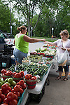 A customer gets her change at the farmers market, Midland, Michigan, USA