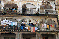 Washing hanging from balconies of ancient building in Havana; Cuba,