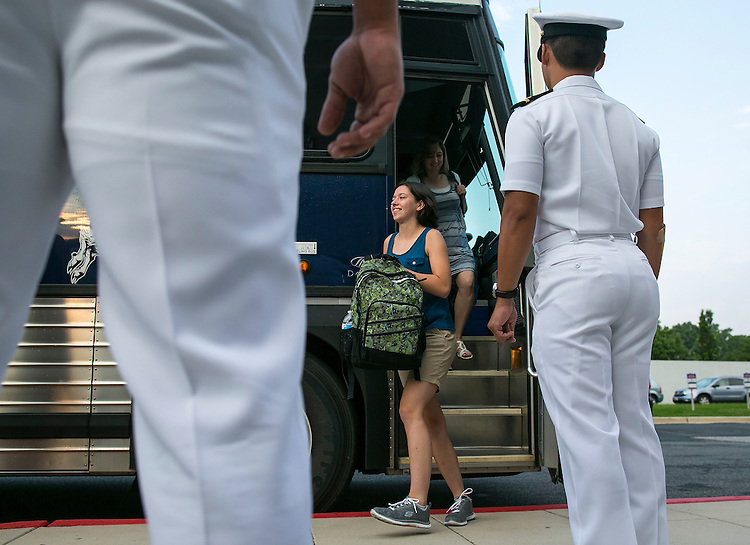 "UNITED STATES - JULY 1 - A plebe heads off the bus to begin Induction Day at the U.S. Naval Academy, Wednesday, July 1, 2015, in Annapolis, Md. More than 1,100 young men and women reported for ""I-Day,"" where they will receive haircuts, medical examinations, new uniforms and instructions on how to salute before taking an oath of office to become members of academy's newest class. (Photo By Al Drago/CQ Roll Call)"