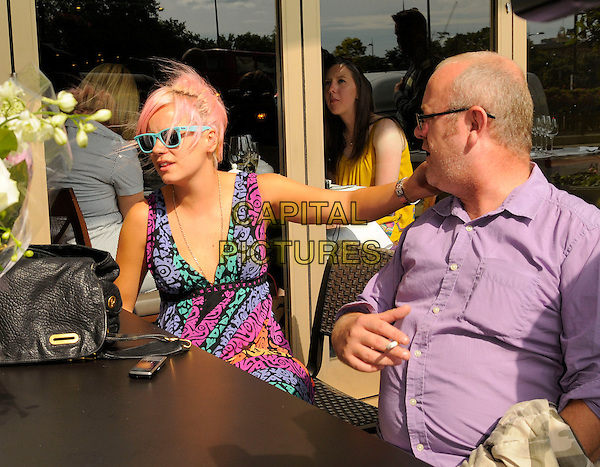 LILY ALLEN .At the O2 Silver Clef Awards Lunch, Hilton Park Lane, London, England, UK, July 4th 2008..half length  blue green pink black print maxi dress bunch of flowers bouquet pink dyed hair turquoise sunglasses ray bans wayfarers sitting table cafe.CAP/CAN.©Can Nguyen/Capital Pictures