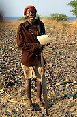 Kasanga, Tanzania. Elderly African man with face and hands deformed by leprosy (Hansens disease).