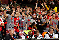 Ohio State fans cheer on the Buckeyes during the second half of the NCAA basketball game against the Wyoming Cowboys at Value City Arena in Columbus on Nov. 25, 2013. The Buckeyes won 65-50. (Adam Cairns / The Columbus Dispatch)