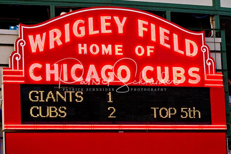 Photo of the Wrigley Field scoreboard lite up during a 2011 game of the Cubs against the Giants.
