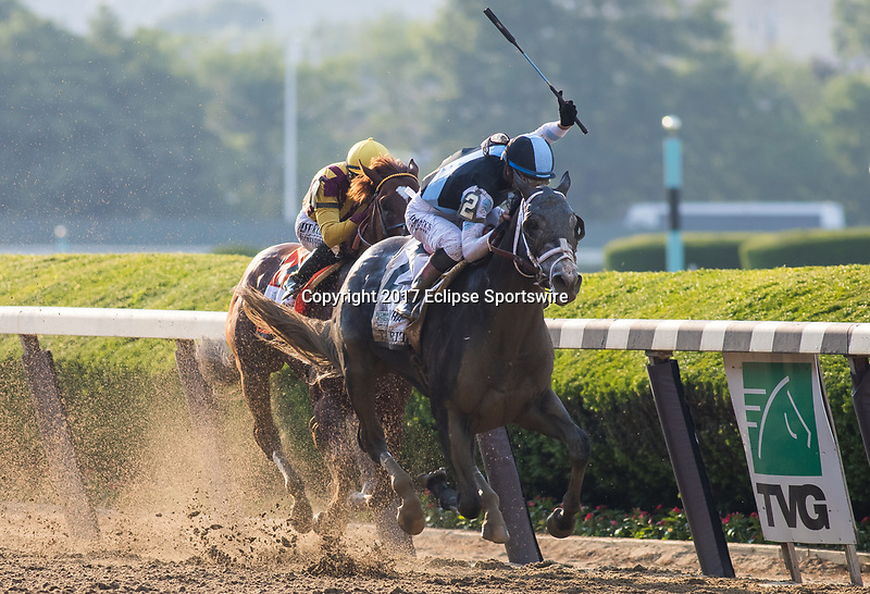 ELMONT, NY - JUNE 10: Tapwrit #2, ridden by Jose Ortiz, wins the 149th Belmont Stakes ahead of Irish War Cry #7, ridden by Rajiv Maragh,on Belmont Stakes Day at Belmont Park on June 10, 2017 in Elmont, New York (Photo by Jesse Caris/Eclipse Sportswire/Getty Images)