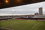 The two teams about to kick-off at the Alexandra Stadium on Gresty Road, Crewe, the home of Crewe Alexandra (in red) before their home game against Leyton Orient in the SkyBet League One. The match was won by the visitors from London by 2-1 with two goals on debut by Chris Dagnall, sending Orient to the top of the league. The match was watched by 4830 spectators.