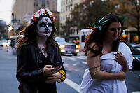 A woman arrives to take part in the Mexican anniversary of Day of the Dead in the Manhattan neighborhood, New York. 25.06.2015. Eduardo MunozAlvarez/VIEWpress.