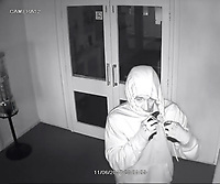 BNPS.co.uk (01202 558833)<br /> Pic: Giggles/BNPS<br /> <br /> One of the alleged burglars.<br /> <br /> A businesswoman who watched in horror on her phone as burglars broke into her play centre and smashed up her office says she wishes she had never seen the footage.<br /> <br /> Lisa Dennis, 52, was in the shower when she received a call from her security firm alerting her that the alarm at her business premises had been triggered.<br /> <br /> Mrs Dennis' mobile phone is linked to a CCTV system at the centre, so while she was hurriedly getting dressed she checked the feed and was shocked to see two men ransacking her office. <br /> <br /> Since Mrs Dennis lives only lives five minutes walk from her business she was quickly on the scene but the burglars had already fled with their ill-gotten gains. <br /> <br /> They made off with &pound;2,500 in cash - including &pound;590 set aside for a nursery outing to the local zoo - and caused &pound;10,000 of damage at Giggles Play Centre in Bournemouth, Dorset.<br /> <br /> Mrs Dennis, 52, who has run the business for three and a half years, says she can't sleep at night because every time she closes her eyes she sees the burglars ransacking her business.