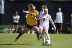 Kim Marshall (10) of the Wake Forest Demon Deacons battles for the ball with Jackie Firenze (9) of the Syracuse Orange at Spry Soccer Stadium on October 26, 2014 in Winston-Salem, North Carolina.  The Demon Deacons and the Orange played to a 0-0 tie.   (Brian Westerholt/Sports On Film)
