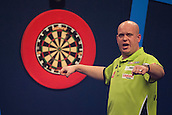 01.01.2014.  London, England.  William Hill PDC World Darts Championship.  Quarter Final Round.  Michael van Gerwen (1) [NED] celebrates a big finish against Robert Thornton (9) [SCO]