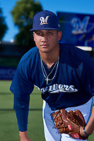 AZL Brewers Blue Eddy Tavarez (64) poses for a photo before an Arizona League game against the AZL Athletics Gold on July 2, 2019 at American Family Fields of Phoenix in Phoenix, Arizona. AZL Athletics Gold defeated the AZL Brewers Blue 11-8. (Zachary Lucy/Four Seam Images)