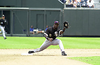 Chicago White Sox second baseman Ray Durham takes the throw to put out Royals shortstop Neifi Perez on a fielders choice in the seventh inning at Kauffman Stadium in Kansas City, Missouri on July 18, 2002.  Kansas City won 5-3.