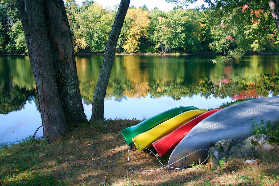 Canoes on riverbank in Orono Maine