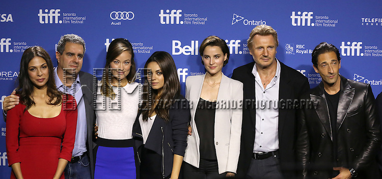 "Moran Atias, producer Michael Nozik, Olivia Wilde, Mila Kunis, Paul Haggis, Loan Chabanol, Liam Neeson and Adrien Brody attending the 2013 Tiff Film Festival Photo Call for ""Third Person""  at the Tiff Bell Lightbox on September 10, 2013 in Toronto, Canada."