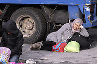 Pictured: A young migrant woman rests by a truck Friday 26 February 2016<br /> Re: Hundreds of refugees that crossed the border from Turkey to the Greek islands, have arrived at the port of Piraeus near Athens, Greece