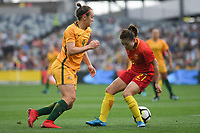 26 November 2017, Melbourne - CAITLIN FOORD (9) of Australia nutmegs XU YANLU (21) of China PR during an international friendly match between the Australian Matildas and China PR at GMHBA Stadium in Geelong, Australia.. Australia won 5-1. Photo Sydney Low