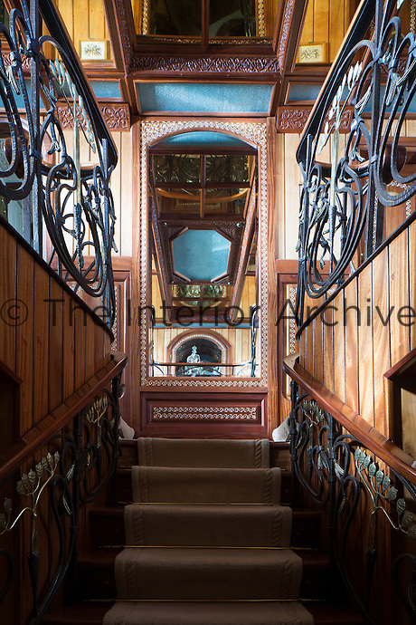 The impressive hand-crafted staircase which leads up to the main saloon and lounge area was inspired by the famous Monnaie du Pape banister created by Art Nouveau designer Louis Majorelle