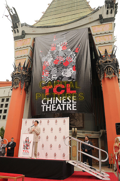 Jackie Chan<br /> at Jackie's Hand and Footprint Cement Ceremony at TCL Chinese Theatre on in Hollywood, California, USA, June 6th 2013. <br /> full length plaid checked jacket suit beige  microphone speaking <br /> CAP/ROT/TM<br /> &copy;Tony Michaels/Roth Stock/Capital Pictures