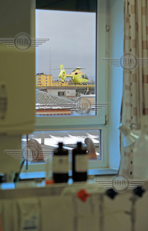 Helicopter from Norweigan Air Ambulance, EC-135, sits on the helipad at Ullevaal hospital.