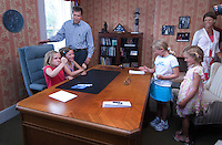 Former Congressman and Fox News host John Kasich and his family play at his desk before he signed copies of his new book, &quot;Stand for Something&quot;, in the Westerville Public Library reproduction of his Washington office. The library opened Sunday, June 11, 2006, the offices containing Kasich's historical records and personal library from his years as a U.S. congressman.<br />