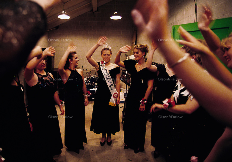 "The Minnesota State Fair's outgoing Princess Kay of the Milky Way, Kimberly Mallory, reviews the infamous ""wave"" with pageant contestants. Only daughters whose parents operate dairy farms, or work on them, are eligible to become county, then regional, dairy princesses."