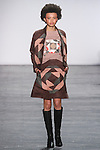 """Model Poppy walks runway in an ultra suede patchwork jacket and skirt, from the Vivienne Tam Fall Winter 2016 """"Cultural Dreamland The New Silk Road"""" collection, presented at NYFW: The Shows Fall 2016, during New York Fashion Week Fall 2016."""