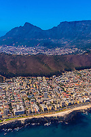 Aerial view of coastline of Cape Town with Signal Hill and Table Mountain in background, South Africa.