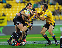 Bismarck Du Plessis tackles James Marshall during the Super Rugby match between the Hurricanes and Sharks at Westpac Stadium, Wellington, New Zealand on Saturday, 9 May 2015. Photo: Dave Lintott / lintottphoto.co.nz
