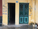 Hanoi, Vietnam, historic city buildings are marked by demolition company graffiti. photo taken July 2008.