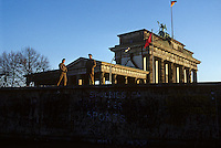 GDR border guards on the wall by the Brandenburg Gate - Berlin Wall west zone.10 November 1989