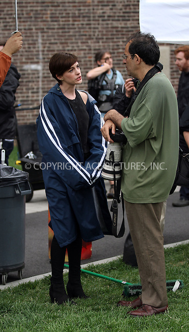 WWW.ACEPIXS.COM<br /> <br /> June 6 2013, New York City<br /> <br /> Actress Anne Hathaway chats to celebrity photographer Steve Sands on the set of the new movie 'Song One' on June 6 2013 in New York City<br /> <br /> By Line: Zelig Shaul/ACE Pictures<br /> <br /> <br /> ACE Pictures, Inc.<br /> tel: 646 769 0430<br /> Email: info@acepixs.com<br /> www.acepixs.com