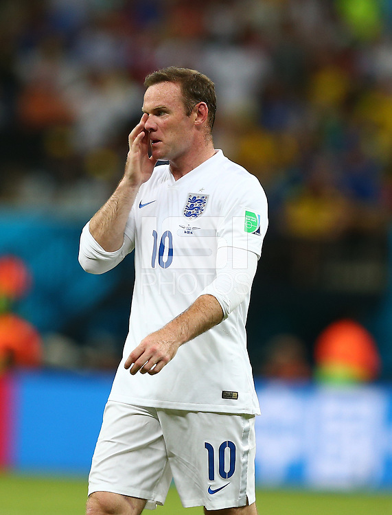 Wayne Rooney of England shows a look of dejection
