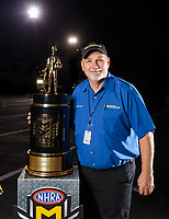 Nov 11, 2018; Pomona, CA, USA; NHRA National Dragster editor Phil Burgess poses for a portrait with the championship trophy during the Auto Club Finals at Auto Club Raceway. Mandatory Credit: Mark J. Rebilas-USA TODAY Sports