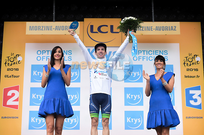 Adam Yates (GBR) Orica-Bike Exchange holds onto the White Jersey on the podium at the end of Stage 20 of the 2016 Tour de France running 146.5km from Meg&egrave;ve to Morzine-Avoriaz, France. 23rd July 2016.<br /> Picture: ASO/A.Broadway | Newsfile<br /> <br /> <br /> All photos usage must carry mandatory copyright credit (&copy; Newsfile | ASO/A.Broadway)