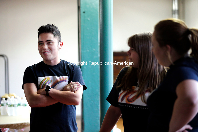 Winsted, CT- 07 August 2017-080717CM03-  Liam Kane of Unionville, talks with other interns at Whiting Mills Studio in Winsted on Monday.  Apprentices who worked with the mural project celebrated the completion of its pilot Digital Storytelling Internship program by talking about the experience and showing off videos they created.      Christopher Massa Republican-American