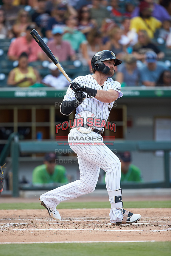 Trey Michalczewski (18) of the Charlotte Knights follows through on his swing against the Gwinnett Braves at BB&T BallPark on July 14, 2019 in Charlotte, North Carolina.  The Stripers defeated the Knights 5-4. (Brian Westerholt/Four Seam Images)