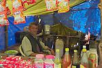 A local man running a  temporary restaurant  near the Bijli Mahadev Temple in the mountains above Kullu in the Kullu Valley, Himachal Pradesh, India.