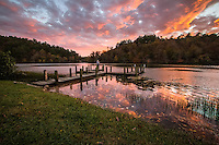 A fall sunset at Shady Lake Recreation are in the Ouachita National Forest.