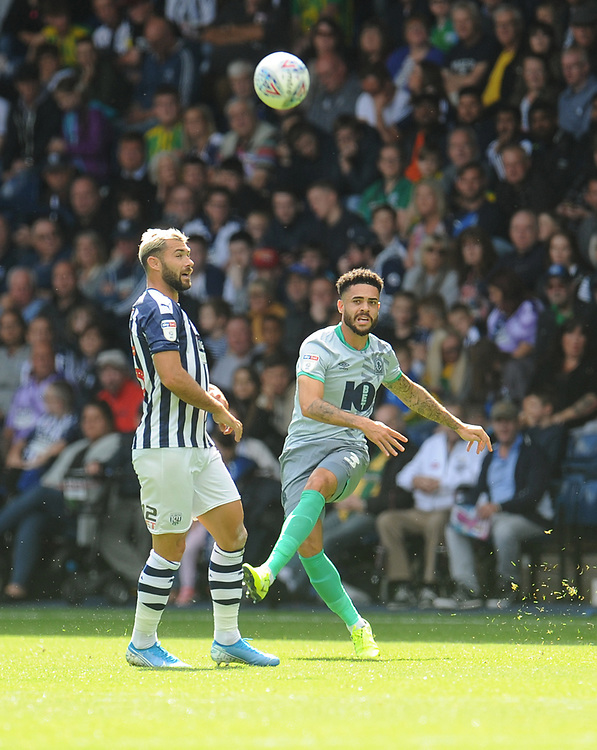 Blackburn Rovers' Derrick Williams under pressure from West Bromwich Albion's Charlie Austin<br /> <br /> Photographer Kevin Barnes/CameraSport<br /> <br /> The EFL Sky Bet Championship - West Bromwich Albion v Blackburn Rovers - Saturday 31st August 2019 - The Hawthorns - West Bromwich<br /> <br /> World Copyright © 2019 CameraSport. All rights reserved. 43 Linden Ave. Countesthorpe. Leicester. England. LE8 5PG - Tel: +44 (0) 116 277 4147 - admin@camerasport.com - www.camerasport.com